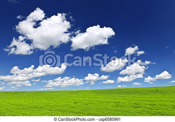 Green rolling hills under blue sky - csp6580991
