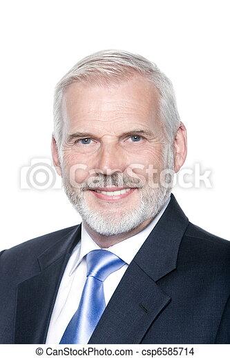 Senior businessman portrait toothy smiling - csp6585714