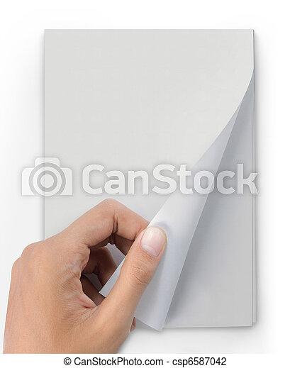 hand turn page of magazine - csp6587042