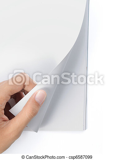 hand turning page of blank magazine - csp6587099