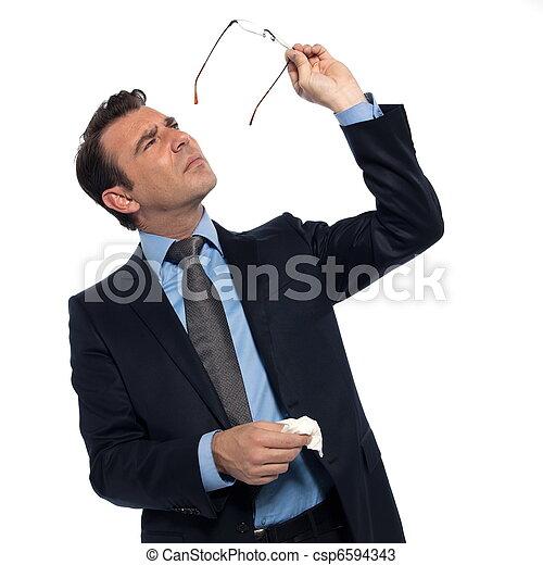 Man cleaning eye glasses - csp6594343
