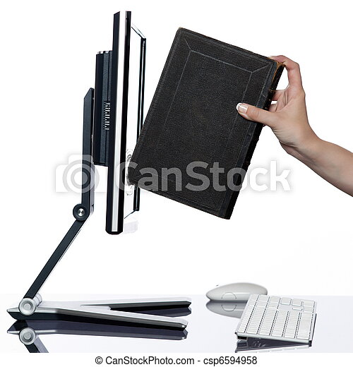 Woman hand put book in computer display - csp6594958