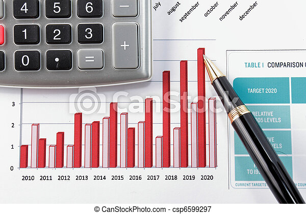 pen showing diagram on financial report - csp6599297