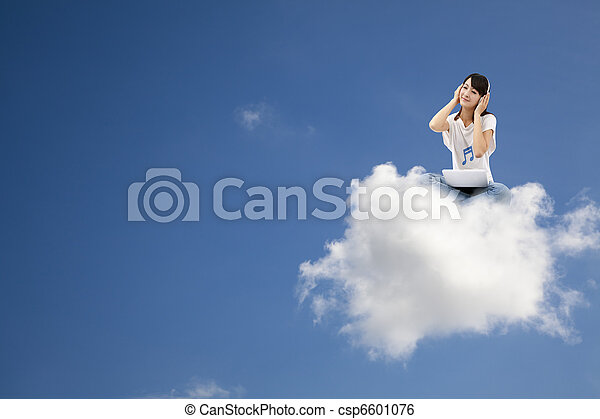 smiling woman listen to music and sitting on the cloud with computer - csp6601076