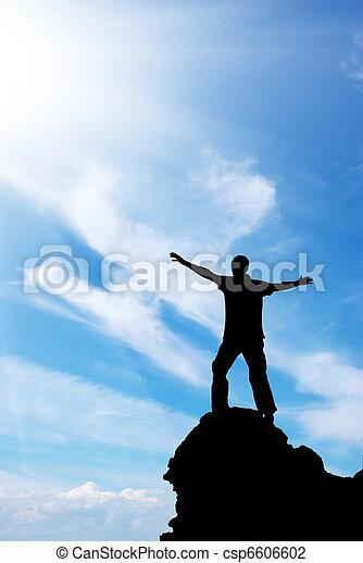 Man on peak of mountain - csp6606602