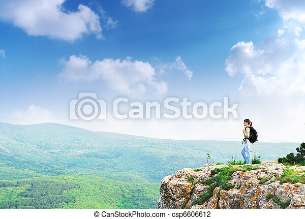 Girl on the peak of mountain - csp6606612