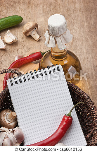 notebook for cooking recipes and vegetables on  cutting board - csp6612156