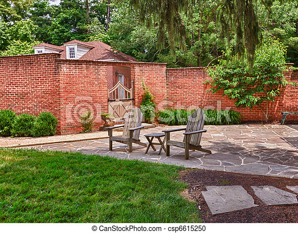 Cape cod chairs on stone patio - csp6615250