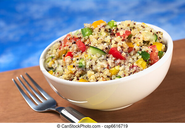 Delicious vegetarian quinoa salad with bell pepper, cucumber and tomatoes (Selective Focus, Focus one third into the bowl)  - csp6616719