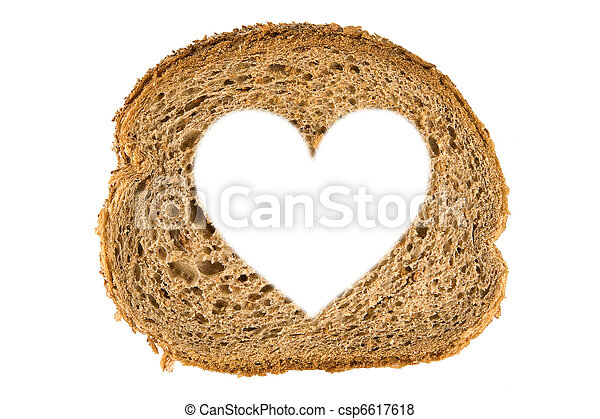 Heart shaped hole in a slice of bread - csp6617618