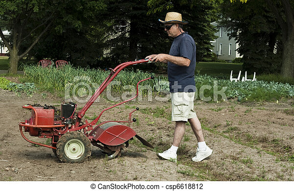 man using a garden tiller - csp6618812