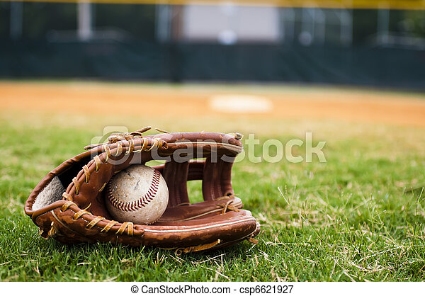 Old Baseball and Glove on Field - csp6621927