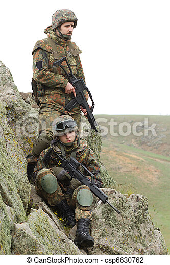 Soldiers in heavy combat ammunition - csp6630762
