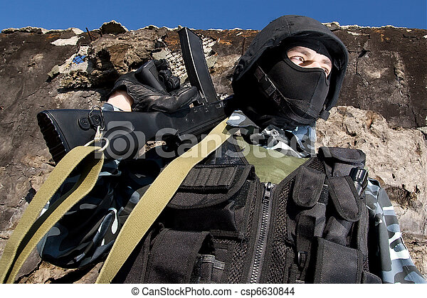 Soldier with automatic rifle - csp6630844