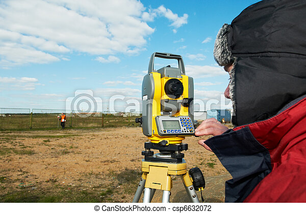 surveyor works with theodolite tacheometer - csp6632072