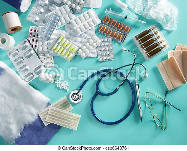 blister medical pills doctor desk pharmaceutical stuff stethoscope green background - csp6643761