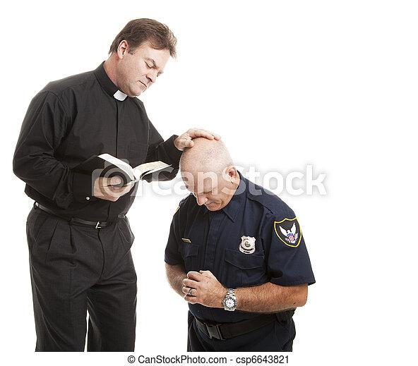 Priest Blesses Policeman - csp6643821