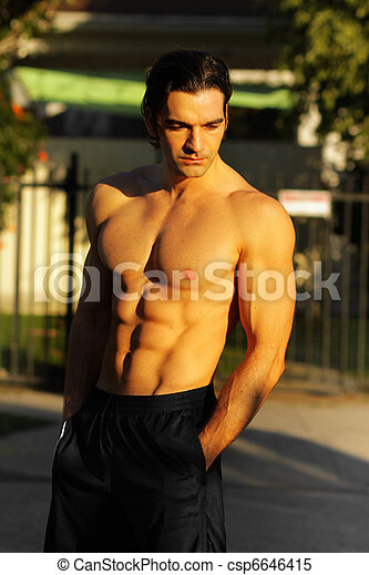 Male fitness model outdoors - csp6646415