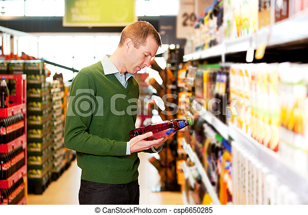 Male Shopping Comparing Products - csp6650285