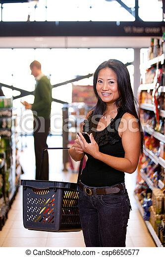 Asian Woman in Supermarket