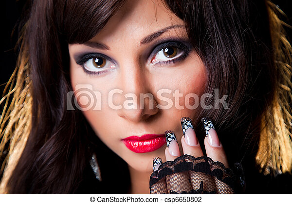 Closeup portrait of beautiful young brunette girl with long dark ringlets and fine art lacy manicure on black background - csp6650802