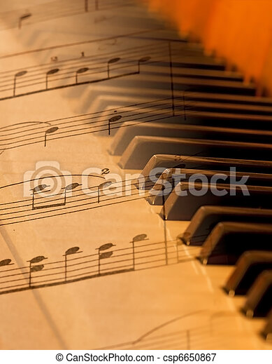 Sheet music blended over piano in soft light blurred - csp6650867