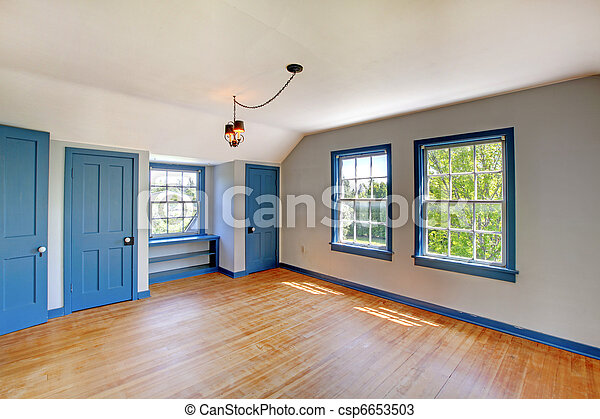 Beautiful historical bedroom with blue doors and trims. - csp6653503