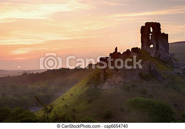 Beautiful dreamy fairytale castle ruins against romantic colorful sunrise - csp6654740