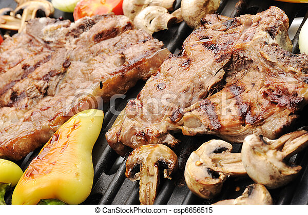 Barbecue, prepared beef meat and different vegetables and mushrooms on grill - csp6656515