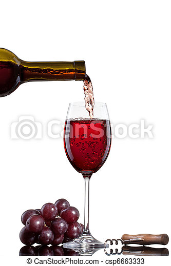 Red wine pouring into glass with grape isolated on white - csp6663333