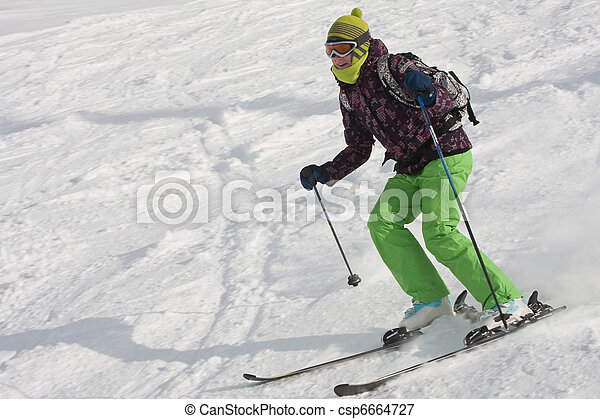 The woman is skiing at a ski resort  - csp6664727
