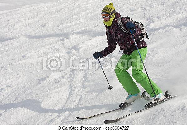 The woman is skiing at a ski resort  - csp6664727