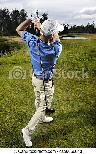 golfer shooting a golf ball - csp6666043