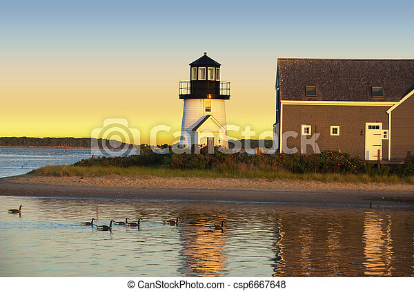 Hyannis harbor lighthouse at sunset - csp6667648