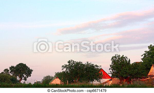 Orange sunset over the village - csp6671479