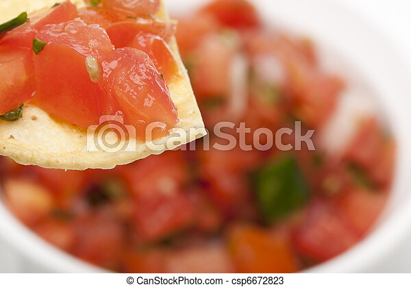 Chips and Fresh salsa in a bowl - csp6672823