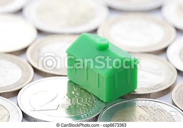Miniature green house on euro coin - csp6673363