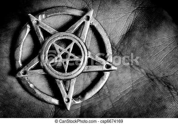 Pentagram in hand macro shot - csp6674169
