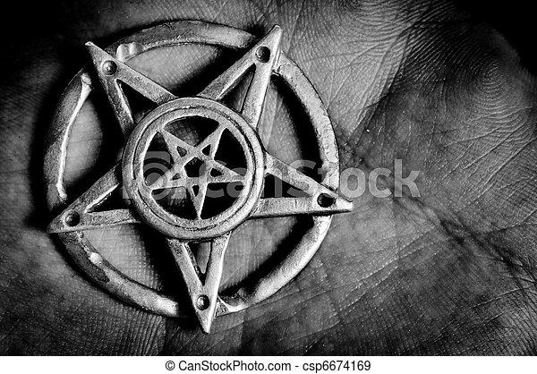Pentagram in hand macro shot  - csp6674169