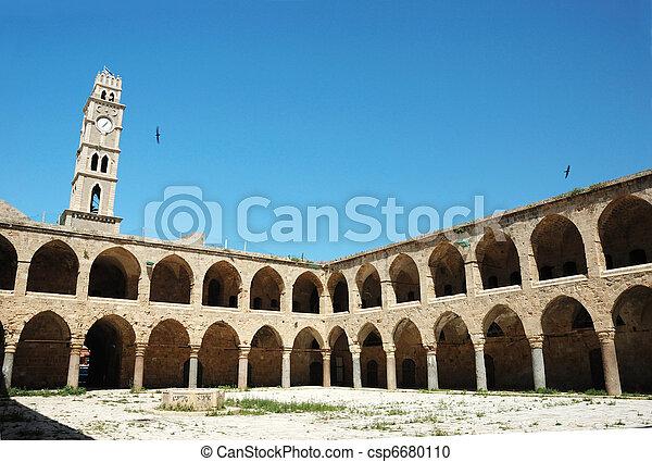 Ottoman landmark building - Khan El-Umdan in Akko, Israel - csp6680110