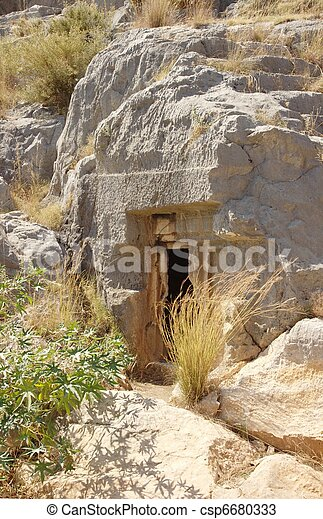 Mysterious cave entrance - csp6680333