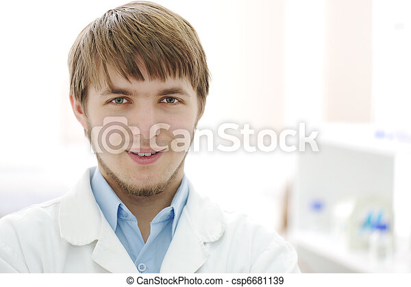 Portrait of young researcher in the lab, hospital worker smiling face - csp6681139