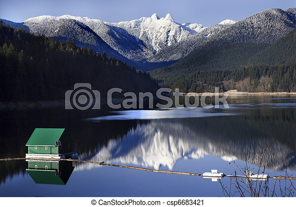 Capilano Reservoir Lake Green Building Dam Snowy Two Lions Snow Mountains Vancouver British Columbia Pacific Northwest - csp6683421