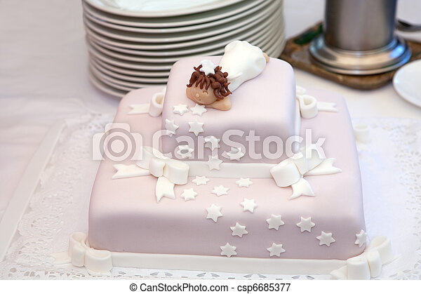 Pink christening cake with little angel on top - csp6685377