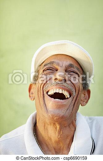 aged latino man smiling for joy - csp6690159
