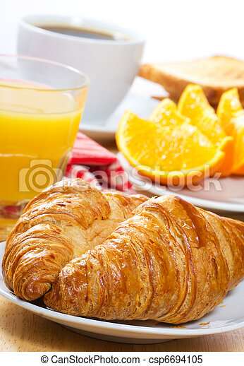 breakfast with croissants, juice and coffee - csp6694105