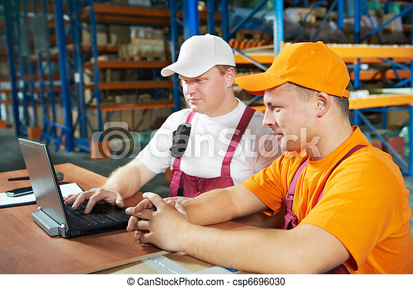 manual workers in warehouse - csp6696030
