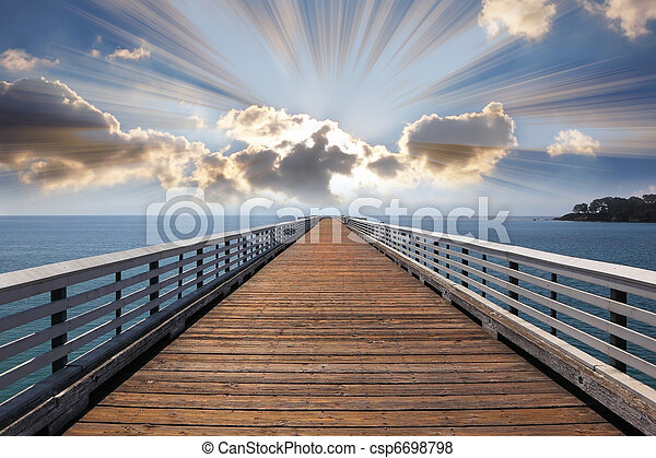 Wooden quay a pier at Pacific coast USA. A sunset and sparkling  - csp6698798