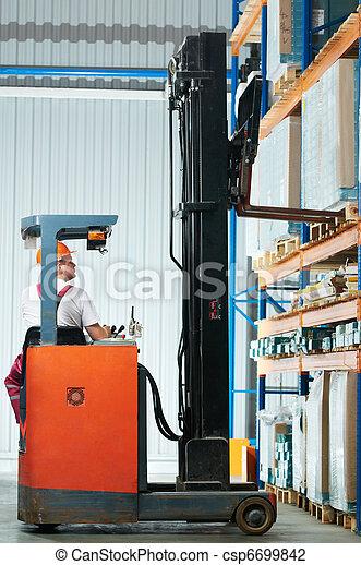 warehouse forklift loader at work - csp6699842