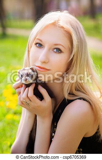 Girl with a polecat - csp6705369